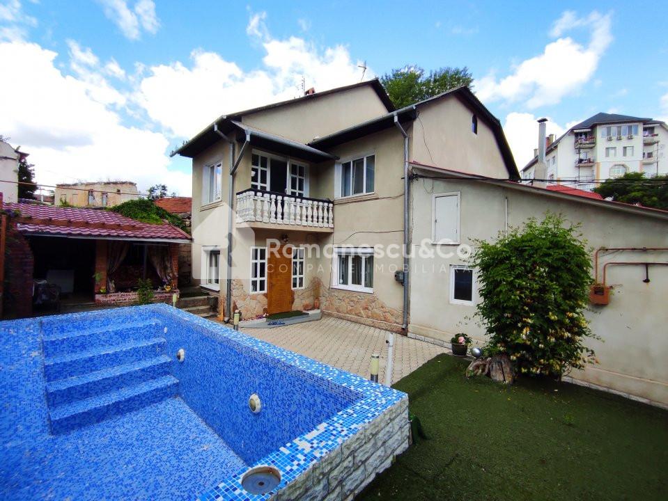 Se vinde casă cu două nivele + teren 1